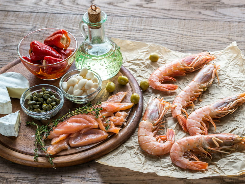 Foods and olive oil, part of the Mediterranean diet. (Alex9500/Envato Elements)