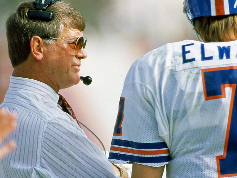 Former coach Dan Reeves on the sideline with former Denver Broncos player John Elway. (Owen C. Shaw, Getty Images)