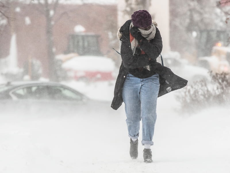 Woman walking through cold.