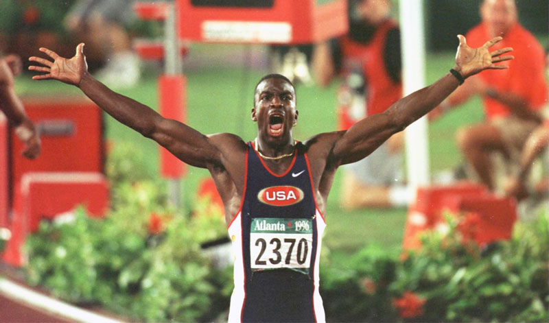 Michael Johnson celebrates after setting a new world record in the men's 200 meters at the 1996 Olympics. (Photo by Simon Bruty/Staff, Getty Images)
