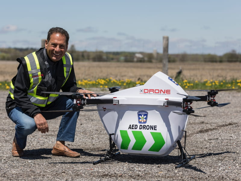 Dr. Sheldon Cheskes, medical director at the Sunnybrook Center for Prehospital Medicine in Toronto, with an AED drone. (Photo courtesy of Drone Delivery Canada)