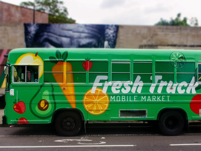 One of the retrofitted Fresh Truck school buses that carries fresh, affordable produce to communities in need. (Photo courtesy of About Fresh)