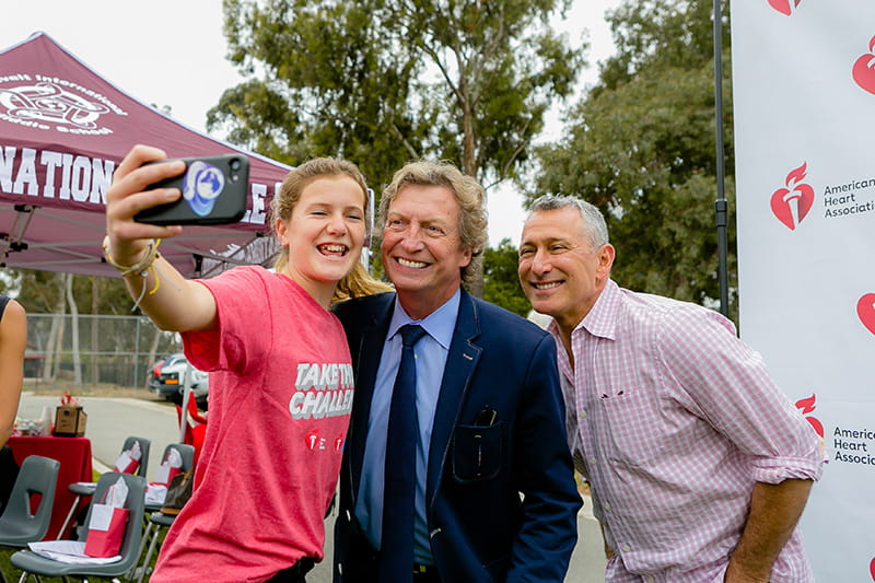 From left: Middle school student Charlotte Ferrier, Nigel Lythgoe and American Dance Movement co-founder Adam Shankman at the American Heart Challenge launch at Roosevelt Middle School in San Diego. (Photo by Sheri Tennison Berg for AHA)