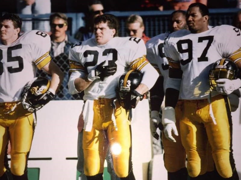 Tim Tyrrell (No. 23) stands between fellow Pittsburgh Steelers Terry O'Shea and Aaron Jones before a game. Tyrrell played for the Steelers in 1989, capping a six-year NFL run that included time with the Atlanta Falcons and Los Angeles Rams. Photo courtesy of Tim Tyrrell