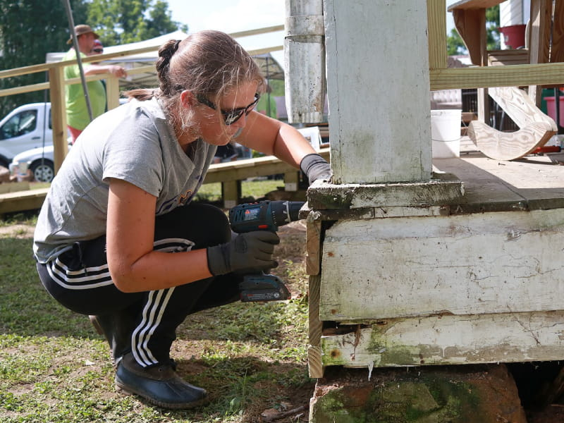 A volunteer from the Hinton Rural Life Center repairing a home to make it safer and healthier. (Photo courtesy of Jared Putnam)
