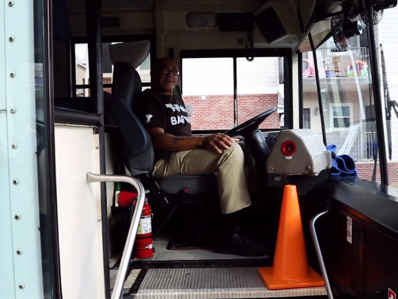 James Amos driving the Brown Bag Bus (Photo courtesy of the YMCA of Greater Montgomery).