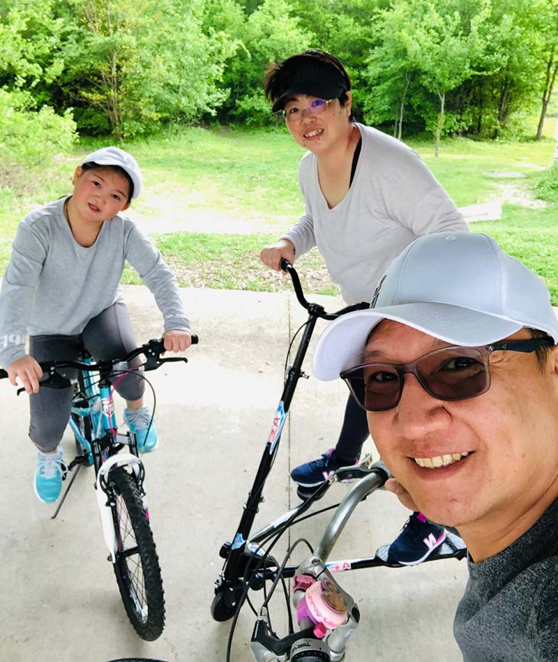Clockwise from left: Cheyenne Kuo and her parents, Francis Huang and James Kuo, take part in an at-home physical education class. Cheyenne spent her fifth grade year learning remotely but will resume in-person classes in August. (Photo courtesy of the Kuo family)