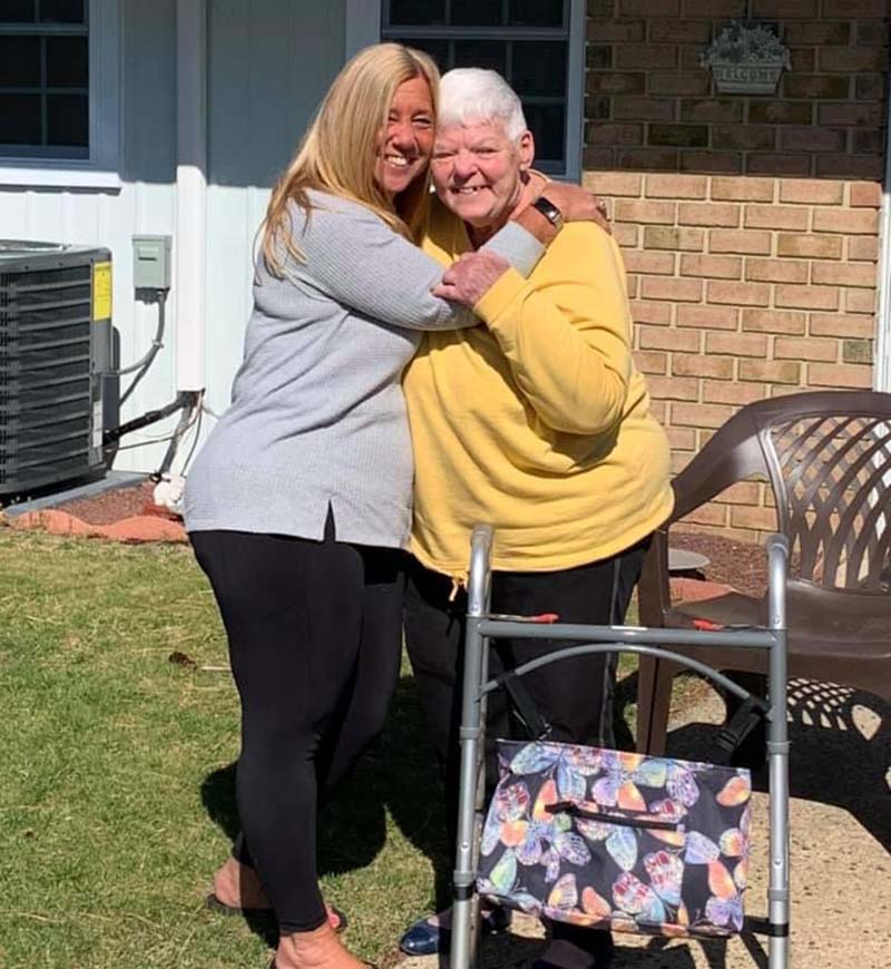 Abby Stopfer Lundy, left, hugs her mother, Barbara Stopfer, for the first time in more than a year, since pandemic lockdowns began. (Photo courtesy of Abby Stopfer Lundy)
