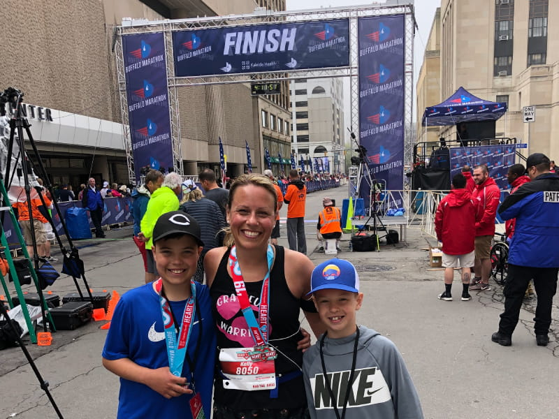 Kelly Naab with her sons at the finish line of the Kaleida Health Heart to Heart Relay in 2019. From left: Cooper, Kelly, and Ryder Naab. (Photo courtesy of Kelly Naab)