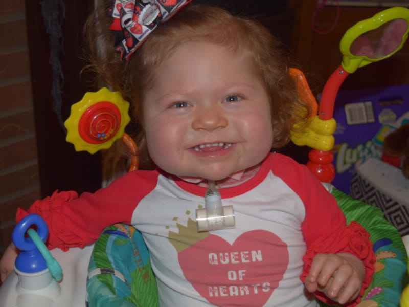 Even after four open-heart surgeries and a transplant, Tessa Agnoli is a happy, smiling two-year-old. (Photo courtesy of Courtney Agnoli)