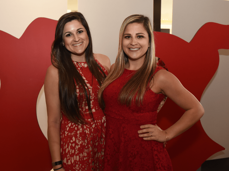 Amanda Tinney (left) and sister, Kelli Tinney, at the 2018 Go Red For Women luncheon in New Orleans.  (Photo courtesy of Jeff Strout Photography)