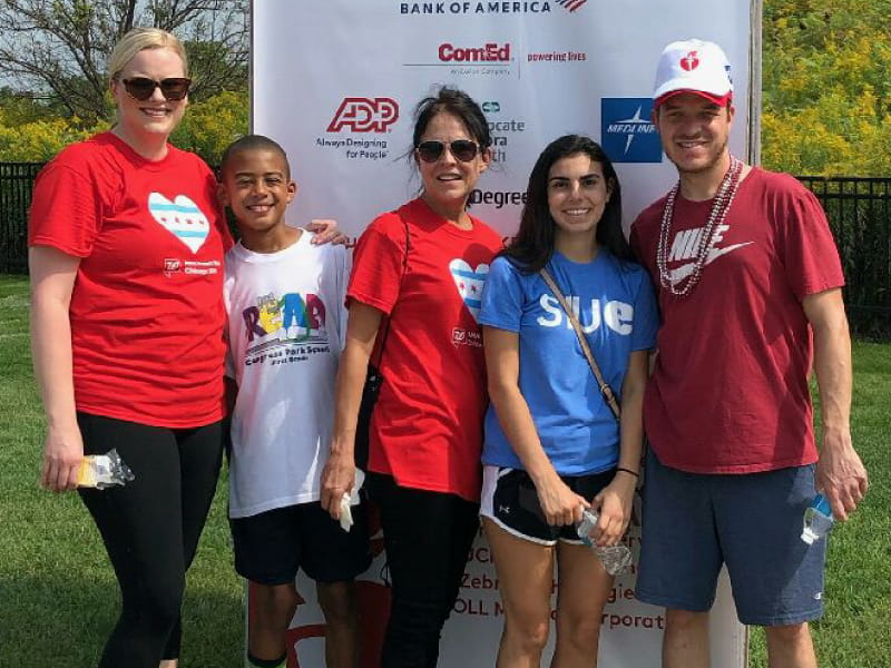 Trent Arnold (right), a heart transplant and stroke survivor, at the finish line of the Chicago Heart Walk with family. (Photo courtesy of Laura Arnold)