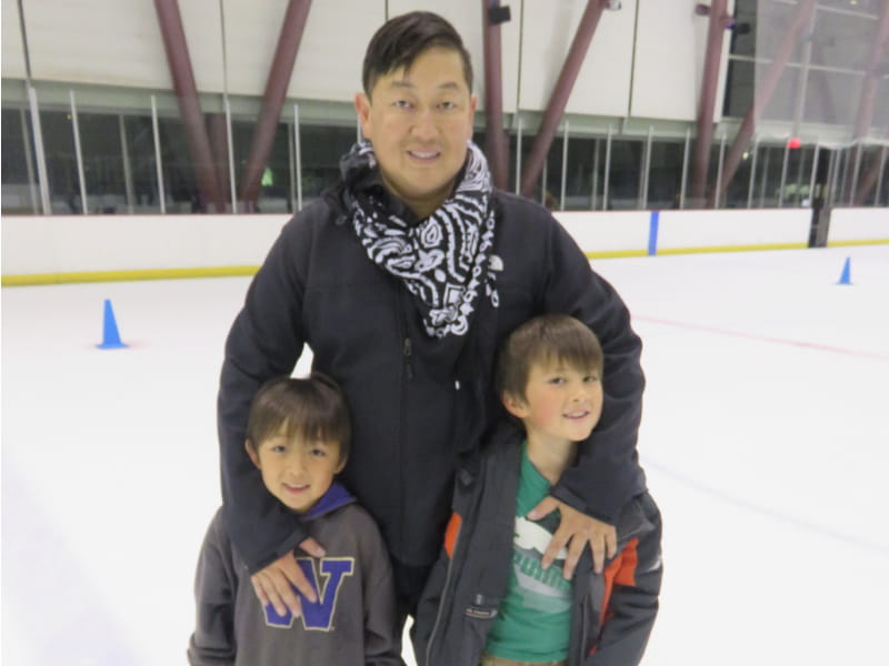 Dave Kim (center) ice skates with sons Brandon Kim (left), and Christian Kim before his stroke. (Photo courtesy of Dave Kim)