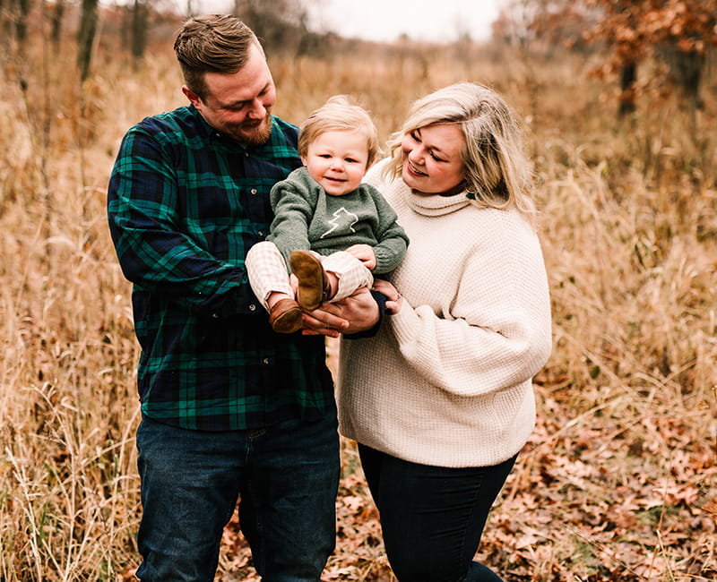 Andrew Goette (left) with his wife, Ashley, and son, Lennon. (Photo by Elle Anne Photography)