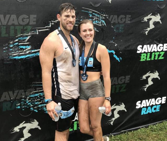 Though Olivia Copeland has Long QT Syndrome and a defibrillator, she still competes in mud runs, finishing a recent race with her boyfriend Jason. (Photo courtesy of Barbara Jackson)