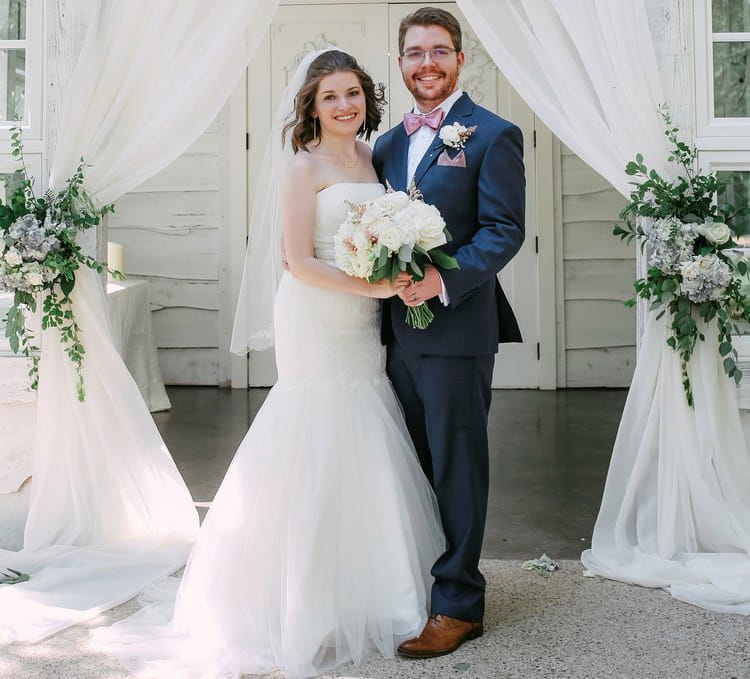 Trenton Cary (right) and his wife, Jessica, on their wedding day in 2018. (Photo courtesy of David Cary)