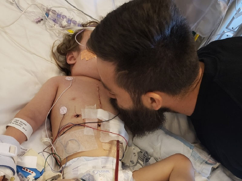 Dad Carlos kisses Ruben after his heart transplant.