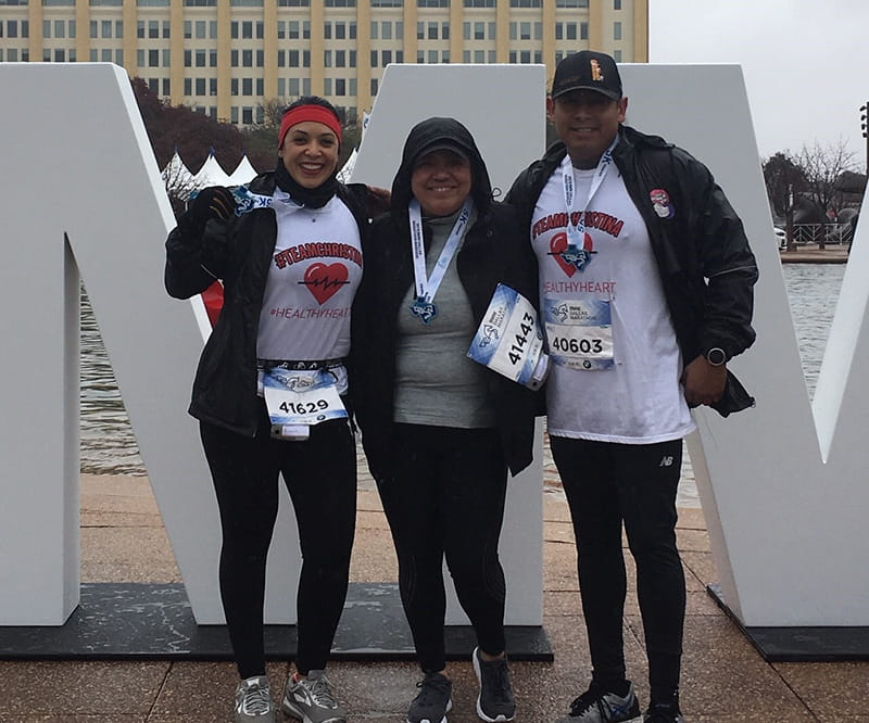 Christina proudly wears the medal she earned at her first 5K, crossing the finish line with friends Juanita and Rey. From left to right: Juanita Cano, Christina Herrera, and Rey Alvarez. (Photo courtesy of Juanita Cano)