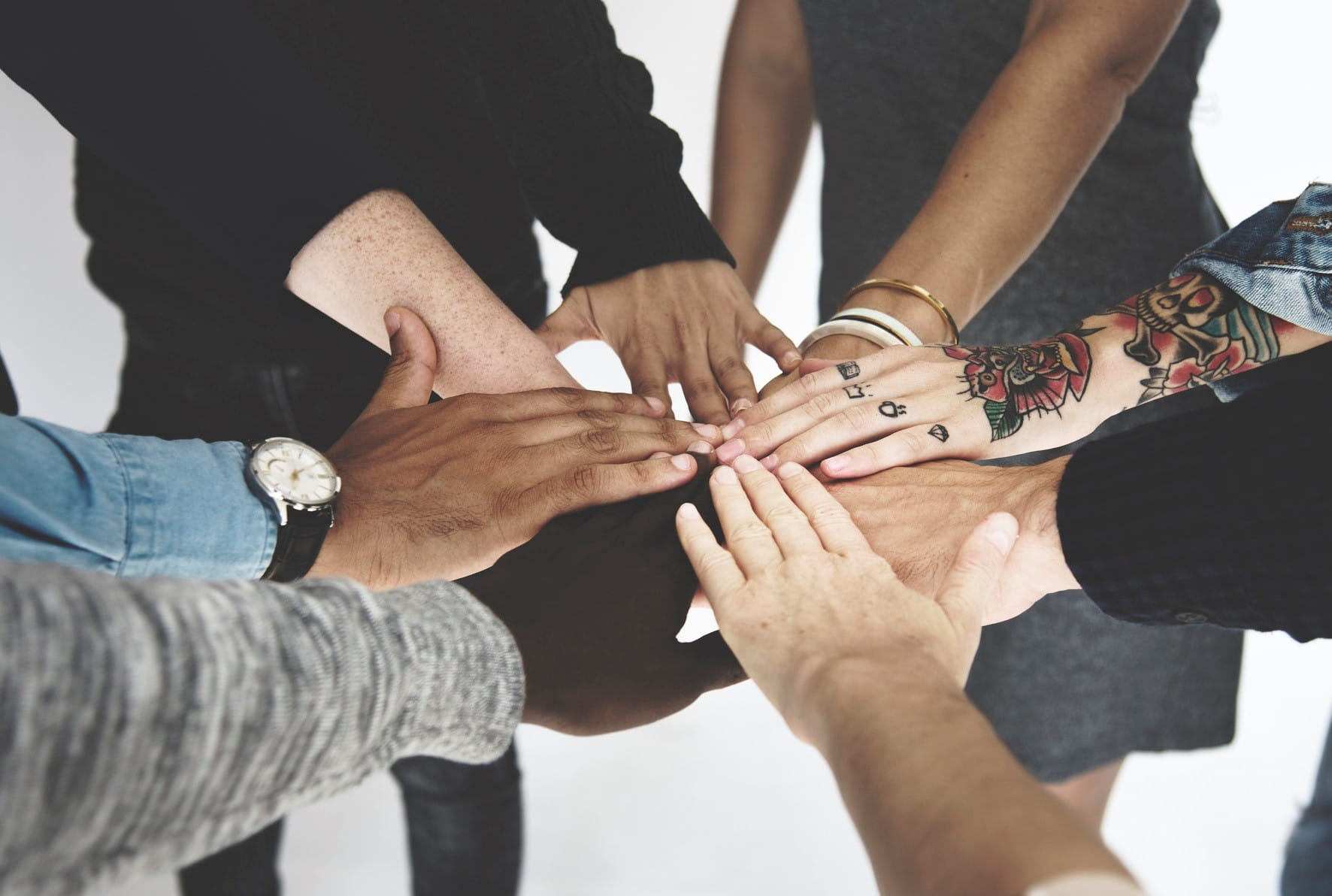 group of diverse people hands together