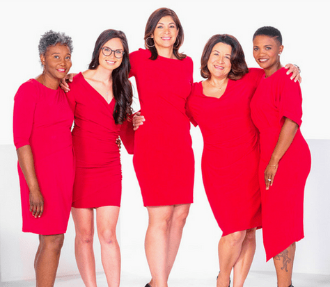 diverse group of women in red dresses