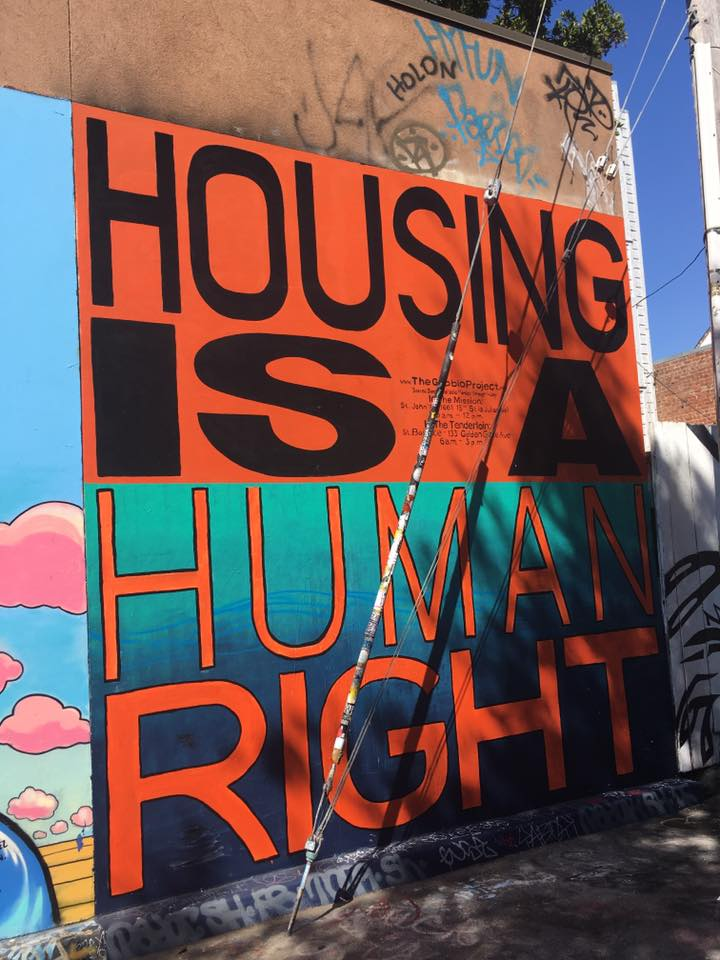 Housing is a Human Right graffiti on a wall